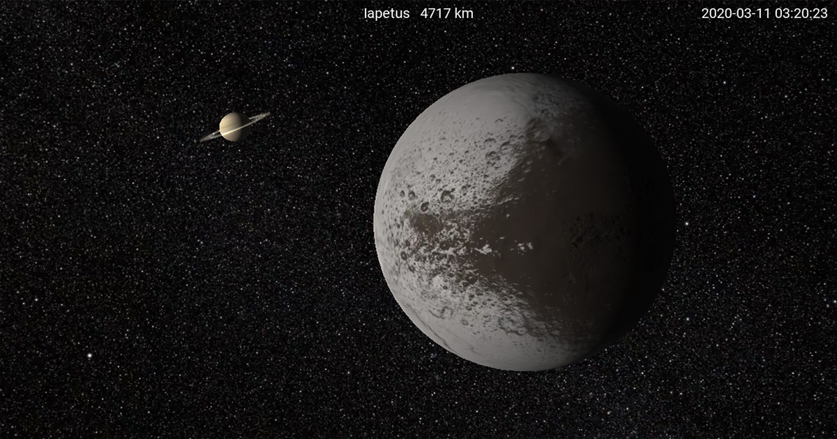 I, Voyager screen capture of Iapetus with Saturn.